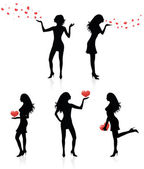 Set of silhouettes of women with hearts. — Stock Vector