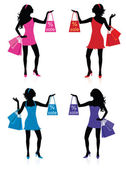 Silhouettes of women with shopping bags. — Stock Vector