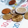 Money euro coins and banknotes background - Stock Photo