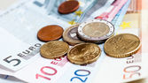 Money euro coins and banknotes background — Stok fotoğraf