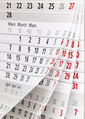 Calendar fragment with half-opened sheets in different angles — Stock Photo