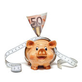 Piggy Bank with 50 Euro note and tape measure — Stock Photo