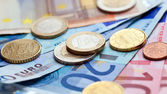 Money euro coins and banknotes background — Stock Photo