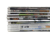 Pile of old newspapers on white — Stock Photo