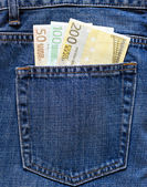 Euro notes in the back pocket of a blue jeans. — Stock Photo