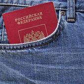 Red Russian passport in pocket of jeans — Stock Photo
