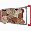 A shopping cart is filled with well-euro coins — Stock Photo