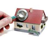 House diagnostics. Model house with hand and stethoscope — Stock Photo