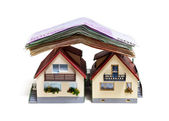 Two houses with Euro banknotes — Stock Photo