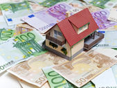House with Euro banknotes — Stock Photo