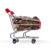 Ein einkaufswagen ist gefüllt mit gut-euro-münzen — Stockfoto