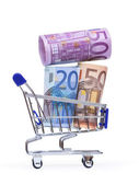 Shopping cart with euro banknotes — Stock Photo