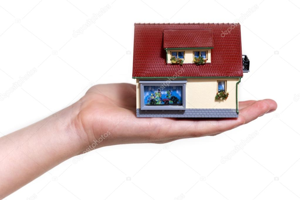 Hand holding small miniature house isolated on white background — Stock Photo #21133665