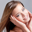 Beautiful vivacious woman with blowing hair — Stock Photo