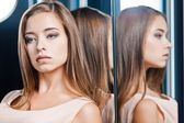 Beautiful woman reflected in a mirror — Stock Photo