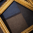 Royalty-Free Stock Photo: Ornate vintage frames with pieces of cloth