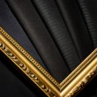 Ornate vintage frame with a piece of black cloth — Stock Photo #14252167