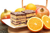 Orange,Pomegranate and tasty cake — Stock Photo