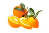Fresh juicy oranges with leafs — Stock Photo