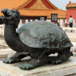 Copper turtle in Forbidden City in Beijing - Stock Photo