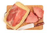 Raw beef in wooden board — Stock Photo
