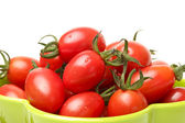 Small tomato on white background — Stock Photo