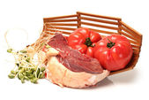 Raw beef meat and tomato on white background — Stock Photo
