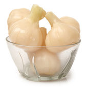 Sweet and sour garlic on white background — Stock Photo