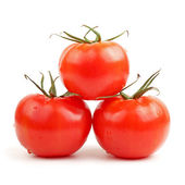 Fresh red tomatoes isolated on white background — Stock Photo