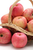 Apples in a basket on a white background. — Stock Photo