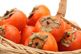 Persimmon on white background — 图库照片