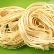Italipasttagliatelle nest — Stock Photo #28730211