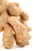 Fresh ginger on a white background — Stock Photo