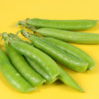 Pea on yellow background — Stock Photo