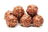 Choklad godis på vit bakgrund — Stockfoto