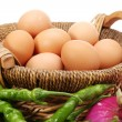 Eggs in basket , red onion ,vegetables — Stock Photo
