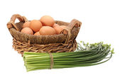 Eggs and chive flower — Stock Photo