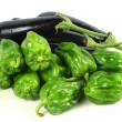 Green peppers and purple eggplant — Stock Photo