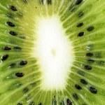 Fresh juicy kiwi background — Stock Photo
