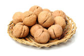 Walnuts in braided plate — Stock Photo