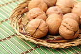 Delicious walnuts in plate — Stock Photo