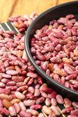 Beans in black bowl — Stock Photo