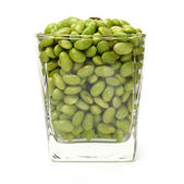 Glass of soy beans — Stock Photo