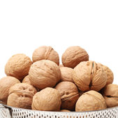Ripe walnuts in bowl — Stock Photo