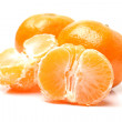 Peeled and whole juicy mandarin — Stock Photo #43590419
