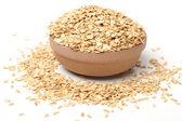 Ceramic bowl of oat flakes — Stock Photo