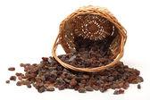 Raisins with basket — Stock Photo