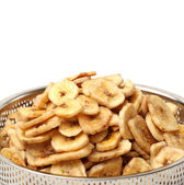 Banana chips in dishware — Stock Photo