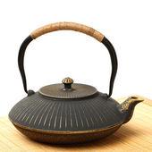 Teapot on mat — Stock Photo