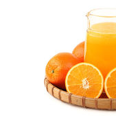 Jug of orange juice — Stock Photo